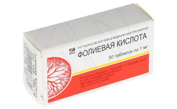 Картонная упаковка с таблетками фолиевой кислоты