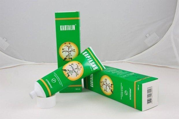 Тюбик и упаковки лекарственной мази Карталин